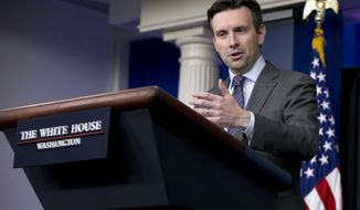 White House press secretary Josh Earnest speaks during the daily news briefing at the White House on Sept. 22, 2014. (Associated Press) **FILE**