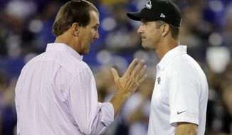 Baltimore Ravens owner Steve Bisciotti, left, speaks with head coach John Harbaugh before an NFL football game against the Pittsburgh Steelers, Thursday, Sept. 11, 2014, in Baltimore. (AP Photo/Patrick Semansky)