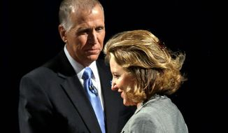 "Sen. Kay Hagan, North Carolina Democrat, has borne the brunt of attacks from challenger Thom Tillis, who accuses her of absenteeism from Senate Armed Services Committee meeting. Mrs. Hagan, in turn, has alleged Mr. Tillis is ""waffling"" about how he'd confront the Islamic State threat. (Associated Press)"
