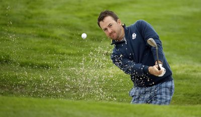 Europe's Graeme McDowell plays out of a bunker onto the 3rd green during a practice round ahead of the Ryder Cup golf tournament, at Gleneagles, Scotland, Tuesday, Sept. 23, 2014. (AP Photo/Matt Dunham)