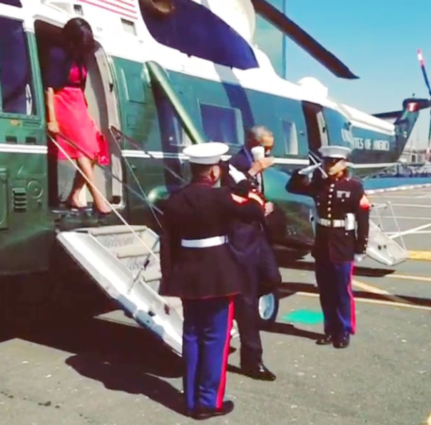 President Obama saluting U.S. Marines while holding a coffee cup. Photo via Instagram