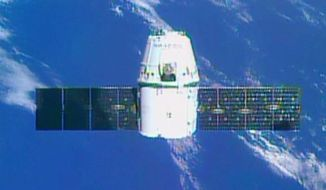 In this photo provided by NASA, the SpaceX Dragon private space freighter approaches the International Space Station, Tuesday, Sept. 23, 2014. Two days after blasting off from Cape Canaveral, Fla., Dragon arrived at the space station containing the first 3-D printer ever launched into orbit. (AP Photo/NASA)