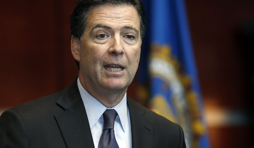 FBI Director James Comey speaks during a news conference at the FBI Albany Field Office on Tuesday, Sept. 23, 2014, in Albany, N.Y. (AP Photo/Mike Groll)