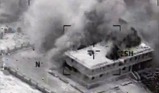 This still image made from video released by the U.S. Central Command on Tuesday, Sept. 23, 2014, shows a structure in Tall Al Qitar, Syria moments after a U.S. airstrike. In three waves of nighttime attacks launched over four hours early on Tuesday, the U.S. and its Arab partners made more than 200 airstrikes against roughly a dozen militant targets in Syria. (AP Photo/US Central Command)