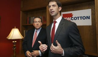 File - In this Aug. 25, 2014 file photo Republican Arkansas U.S. Senate candidate Tom Cotton, right, speaks in Little Rock, Ark., after being endorsed by Arkansas Gov. Mike Huckabee, left, in his race against Democratic Sen. Mark Pryor. Arkansas voters have been bombarded with political ads for the state's Senate race that started more than a year ago when Republicans identified the race as a possible key to winning control of the Senate. (AP Photo/Danny Johnston, File)