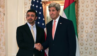 U.S. Secretary of State John Kerry, right, shakes hands with United Arab Emirates Foreign Minister Abdullah bin Zayed before a meeting, Tuesday, Sept. 23, 2014, in New York. (AP Photo/Julie Jacobson)