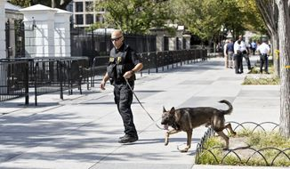 A U.S. Secret Service K-9 sweeps the sidewalk around the White House facing Pennsylvania Avenue, in Washington, Tuesday, Sept. 23, 2014, after protests by anti-war activists who blocked the entrance to the northwest gate. Security around the White House perimeter has been intensified since last Friday when a 42-year-old Army veteran climbed over the fence and dashed across the north lawn and entered the executive mansion before being stopped.  (AP Photo/J. Scott Applewhite)