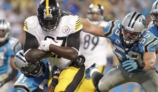 Pittsburgh Steelers' LeGarrette Blount (27) runs between Carolina Panthers' Robert Golden (21) and Luke Kuechly (59) for a touchdown during the second half of an NFL football game in Charlotte, N.C., Sunday, Sept. 21, 2014. The Steelers won 37-19. (AP Photo/Bob Leverone)