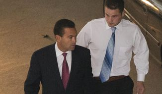 Philip Williams, right, accompanied by attorney Fortunato Perri Jr. walks to a police station Wednesday, Sept. 24, 2014, in Philadelphia. Williams, Kevin Harrigan and Kathryn Knott are being charged with conspiracy, aggravated and simple assault, and reckless endangerment in the Sept. 11 beating of a gay couple during a late-night encounter in Philadelphia. (AP Photo/Matt Rourke)