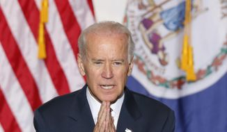 Vice President Joe Biden gestures during a speech in Norfolk, Va., Wednesday, Sept. 24, 2014.  Biden visited the area to talk about a new federal transportation grant. (AP Photo/Steve Helber)