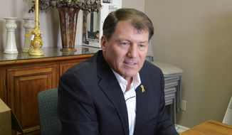 Former South Dakota Gov. Mike Rounds is seen in Sioux Falls on Feb. 20, 2014. (Associated Press) **FILE**