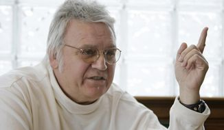 """FILE - In this Feb. 25, 2010, file photo, former U.S. Rep. James Traficant talks about politics at a diner in Boardman, Ohio. Traficant, who spent time in prison on corruption and racketeering charges, has been critically injured in a tractor accident at his northeast Ohio home. Traficant's wife, Tish, told The (Youngstown) Vindicator that the 73-year-old former congressman was in """"very critical condition"""" on Wednesday, Sept. 24, 2014, following the Tuesday night accident on his family farm in Greenford, Ohio. (AP Photo/Tony Dejak, File)"""