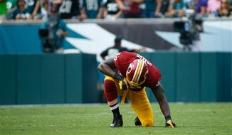 Washington Redskins' Brian Orakpo takes a knee during the second half of an NFL football game against the Philadelphia Eagles, Sunday, Sept. 21, 2014, in Philadelphia. (AP Photo/Matt Rourke)