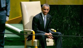 United States President Barack Obama waits to address the 69th session of the United Nations General Assembly, at U.N. headquarters Wednesday, Sept. 24, 2014. (AP Photo/Richard Drew)
