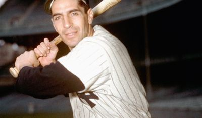 Yankees infielder Phil Rizzuto with bat in hand poses March 1950. (AP Photo)