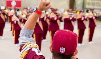 Dave Zelonis of Bowie, Md. cheers for the Redskins marching band outside the stadium before the Washington Redskins play the New York Giants in NFL football at FedExField, Landover, Md., Thursday, September 25, 2014. (Andrew Harnik/The Washington Times)