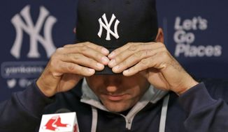 New York Yankees shortstop Derek Jeter adjusts his cap as he talks with reporters prior to the Yankees' baseball game against the Boston Red Sox at Fenway Park in Boston, Friday, Sept. 26, 2014. (AP Photo/Charles Krupa)