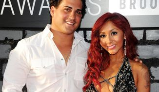 """Nicole """"Snooki"""" Polizzi (right) and Jionni LaValle arrive at the MTV Video Music Awards in the Brooklyn borough of New York on Aug. 25, 2013. (Evan Agostini/Invision/Associated Press) **FILE**"""