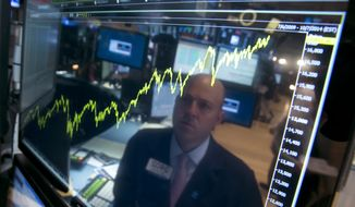 CORRECTS TO SAY THAT BOND PURCHASES ARE SET TO END IN OCTOBER INSTEAD OF NOVEMBER - FILE - In this Thursday, July 3, 2014, file photo, specialist Jay Woods is reflected in a screen at his post that shows five years of the Dow Jones industrial average, on the floor of the New York Stock Exchange. History shows higher interest rates don't always upend stocks. The Fed is set to end its bond purchases in October and most economists expect the first short-term rate hike by mid-2015. These early increases, analysts say, are unlikely to derail the current bull market for stocks, because the Fed is raising rates in response to a growing economy. (AP Photo/Richard Drew, File)
