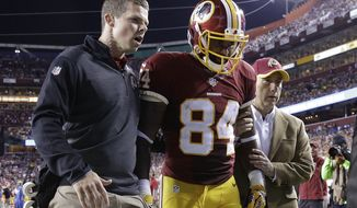 Washington Redskins tight end Niles Paul (84) walks off the field after an injury during the first half of an NFL Thursday night football game against the New York Giants in Landover, Md., Thursday, Sept. 25, 2014. (AP Photo/Patrick Semansky)