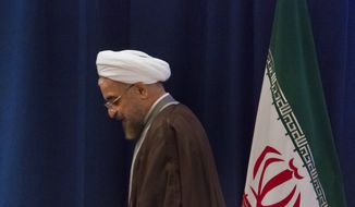 "Iran's President Hassan Rouhani leaves after a news conference in New York on Friday, Sept. 26, 2014. In his wide-ranging speech to the U.N. General Assembly on Thursday, Rouhani warned that Islamic terrorists were creating chaos in the Mideast to destroy civilization and generate anti-Muslim hatred, saying they wanted to create ""a fertile ground for further intervention of foreign forces in our region."" He also said a nuclear agreement was possible before the November deadline if the West wants a deal and shows flexibility. (AP Photo/Bebeto Matthews)"