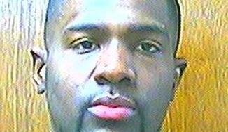 This March 25, 2013 photo provided by the Oklahoma Department of Corrections shows Alton Nolen, of Moore, Okla. Prison records indicate that Nolen, the suspect in the beheading of a co-worker at an Oklahoma food processing plant Thursday, Sept. 25, 2014, had spent time in prison and was on probation for assaulting a police officer. (AP Photo/Oklahoma Department of Corrections)