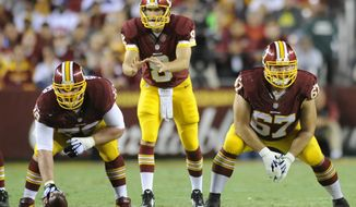 Washington Redskins guard Josh LeRibeus (67) lines up next to veteran center Kory Lichtensteiger against the New York Giants at FedExField, Landover, Md., Sept. 25, 2014. (Preston Keres/Special for The Washington Times)