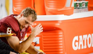 Washington Redskins quarterback Kirk Cousins (8) sits on the bench after throwing his fourth interception as the Washington Redskins play the New York Giants in NFL football at FedExField, Landover, Md., Thursday, September 25, 2014. (Andrew Harnik/The Washington Times)