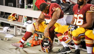 Washington Redskins tackle Trent Williams (71) sits injured on the bench as the Washington Redskins play the New York Giants in NFL football at FedExField, Landover, Md., Thursday, September 25, 2014. (Andrew Harnik/The Washington Times)