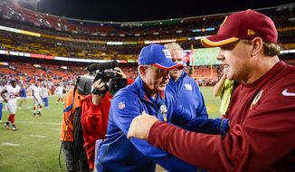 New York Giants head coach Tom Coughlin and Washington Redskins head coach Jay Gruden greet each other as the Washington Redskins lose to the New York Giants 45-14 in NFL football at FedExField, Landover, Md., Thursday, September 25, 2014. (Andrew Harnik/The Washington Times)