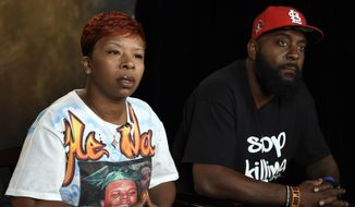 "The parents of Michael Brown, Lesley McSpadden, left, and Michael Brown, Sr., right, speak to The Associated Press during an interview in Washington, Saturday, Sept. 27, 2014. Michael Brown's parents say they are unmoved by the Ferguson police chief's apology in their son's shooting death by a police officer. Instead, Lesley McSpadden and Michael Brown Sr. told The Associated Press they would rather see an arrest, and Brown Sr. said he wants the police officer ""in handcuffs.""  (AP Photo/Susan Walsh)"