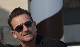 Bono arrives at the Cipriani hotel in Venice, Italy, Saturday, Sept. 27, 2014 to attend George Clooney's wedding ceremony. (AP Photo/Andrew Medichini)
