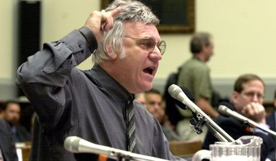 FILE - In this July 15, 2002 file photo, Rep. James Traficant, D-Ohio, testifies on Capitol Hill in Washington before the House Ethics Committee. Traficant, who spent time in prison on corruption and racketeering charges, has died after being critically injured in a tractor accident at his northeast Ohio home.   He was 73.  Dave Betras, the Mahoning County Democratic Party chairman, says Traficant died Saturday, Sept. 27, 2014 in the hospital. Betras says he was notified by the Traficant family attorney. (AP Photo/Dennis Cook, File)