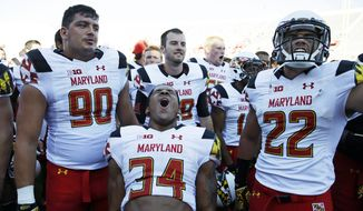 Maryland wide receiver Jacquille Veii (34) react with teammates after Maryland defeated Indiana 37-15 in an NCAA college football game Saturday, Sept. 27, 2014, in Bloomington, Ind. (AP Photo/Darron Cummings)
