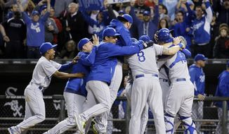 Kansas City Royals players and coaching staff celebrate after the Royals defeated the Chicago White Sox 3-1 in a baseball game in Chicago on Friday, Sept. 26, 2014. (AP Photo/Nam Y. Huh)