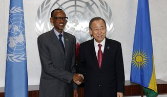 President Paul Kagame of Rwanda, left, meets with United Nations Secretary-General Ban Ki-moon on the sidelines of the 69th session of the U.N. General Assembly at U.N. headquarters, Sept. 27, 2014. (AP Photo/Jason DeCrow)