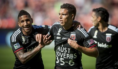 D.C. United's Sean Franklin congratulates Luis Silva on his early goal on Saturday, Sept. 27, 2014 at RFK Stadium in Washington D.C. Silva's goal in the 10th minute was enough to lift United to a 1-0 win over the Philadelphia Union at RFK Stadium. (Pete Marovich for the Washington Times)