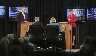 "Iowa state Sen. Joni Ernst (right), republican candidate for U.S. Senate, sparred with democratic candidate U.S. Rep. Bruce Braley on Sunday, over immigration and the definition of ""amnesty."" The Des Moines Register released a poll over the weekend that showed Mrs. Ernst had opened up a 6-percentage-point lead over Mr. Braley. (Associated Press)"
