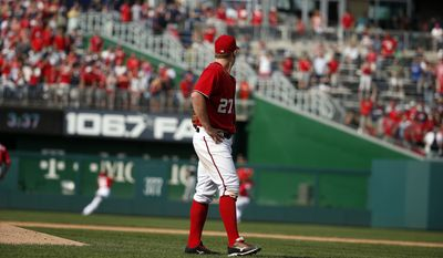 Washington Nationals starting pitcher Jordan Zimmermann (27) watches as the last out is caught by left fielder Steven Souza (21) in the ninth inning of a baseball game against the Miami Marlins at Nationals Park, Sunday, Sept. 28, 2014, in Washington. Zimmermann pitched a no-hitter, and the Nationals won 1-0.(AP Photo/Alex Brandon)