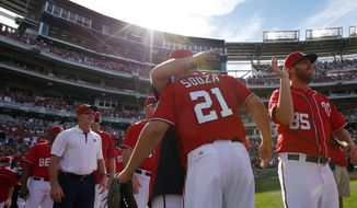 Washington Nationals left fielder Steven Souza (21) celebrates with his teammates after a baseball game against the Miami Marlins at Nationals Park, Sunday, Sept. 28, 2014, in Washington. Souza made a diving catch to end the game. Jordan Zimmermann pitched a no-hitter, and the Nationals won 1-0. (AP Photo/Alex Brandon)