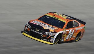Jeff Gordon drives during practice for the NASCAR Sprint Cup series auto race, Saturday, Sept. 27, 2014, at Dover International Speedway in Dover, Del. (AP Photo/Nick Wass)