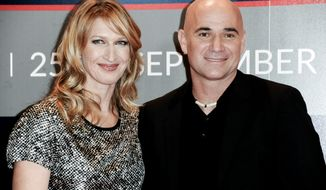 Steffi Graf, left, and Andre Agassi, are wealthy tennis players. Among millionaires, women are preferring conservatives, according to a new study. (Photo by Richard Shotwell/Invision/AP)
