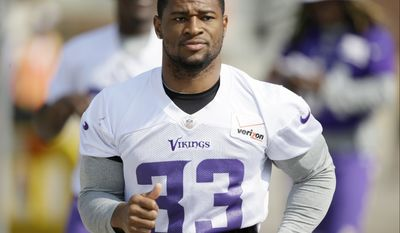 Minnesota Vikings strong safety Jamarca Sanford walks to the field before an NFL football training camp practice, Saturday, Aug. 2, 2014, in Mankato, Minn. (AP Photo/Charlie Neibergall)