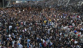 Pro-democracy protesters flood the Central financial district in Hong Kong Monday, Sept. 29, 2014. Protesters expanded their rallies throughout Hong Kong on Monday, defying calls to disperse in a major pushback against Beijing's decision to limit democratic reforms in the Asian financial hub. (AP Photo/Wong Maye-E)