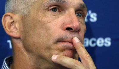 New York Yankees manager Joe Girardi's eyes fill with tears as he talks about Derek Jeter after the last baseball game of Jeter's career, against the Boston Red Sox Sunday, Sept. 28, 2014, at Fenway Park in Boston. Jeter had an RBI single in the Yankees' 9-5 win.  (AP Photo/Elise Amendola)
