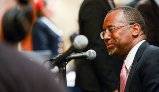 Ben Carson is interviewed by a radio station after speaking at the National Security Action Summit II held at the Marriott Wardman Hotel, Washington, D.C., Monday, Sept. 29, 2014. (Andrew Harnik/The Washington Times)