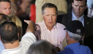 Ohio Gov. John Kasich greets supporters after a GOP Get Out the Vote rally in Independence, Ohio, Monday, Sept. 29, 2014. (AP Photo/Mark Duncan)