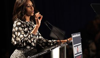 First lady Michelle Obama speaks on behalf of Wisconsin Democratic gubernatorial candidate Mary Burke at a campaign rally Monday, Sept. 29, 2014, in Milwaukee. (AP Photo/Darren Hauck)