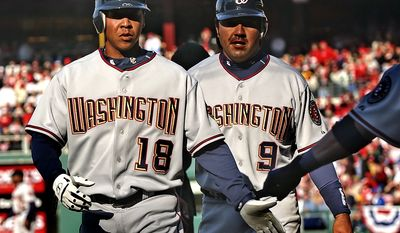 Washington Nationals' Terrmel Sledge (18) and Vinny Castilla walk back to the dugout after Sledge homered to right and Castilla scored against the Philadelphia Phillies in the sixth inning Monday, April 4, 2005, in Philadelphia. (AP Photo/Bill Kostroun)