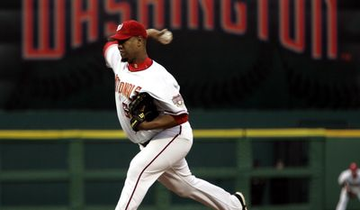 Washington Nationals pitcher Livan Hernandez throws the first pitch of the game against the Arizona Diamondbacks in the Washington Nationals home opener Thursday, April 14, 2005, in Washington. (AP Photo/Evan Vucci)